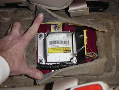 GM sensing and diagnostic module, aka the black box / EDR / event data recorder / SDM air bag module. Mounted under center console 2001 Cadillac DTS
